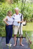 Happy seniors with digital tablet Stock Photography