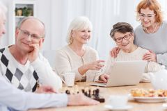 Happy seniors in retirement home Stock Photo
