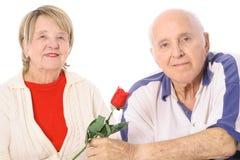 Happy seniors with Valentines rose stock photos