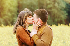 Happy sensual couple kissing in love outdoor into the depth of b Royalty Free Stock Photography