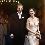 Happy sensual sexual bride and handsome groom outside church thr Stock Images