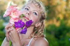 Happy sensual woman with  flowers Stock Photos