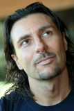 Happy serenely pensive man / Italian men. Expression of a happy man but serenely pensive / Slight smile / Long hair with goatee stock image