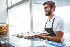 happy server holding pastry Stock Image