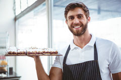 Happy server holding pastry Royalty Free Stock Photo