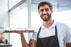 happy server holding pastry Royalty Free Stock Photo