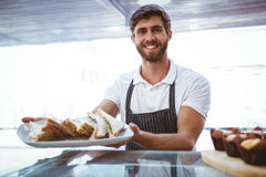 Happy server showing sandwich Stock Photography
