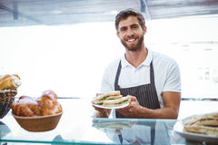 Happy server showing sandwich Royalty Free Stock Images