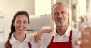 Happy server team looking at camera. In high quality 4k format stock video