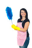 Happy service cleaning woman. In pink apron holding blue brush for dust isolated on white background Royalty Free Stock Photos