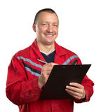 Happy service man with clipboard. Isolated on white Royalty Free Stock Photography