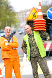 Happy service men road workers Royalty Free Stock Image