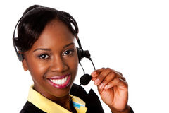 Happy Service Operator. Beautiful happy smiling African business woman customer service representative operator, isolated Royalty Free Stock Photography