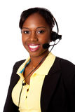 Happy Service Operator. Beautiful happy smiling African business woman customer service representative operator, isolated Stock Photo