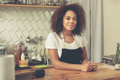 Happy service woman looking for clients in coffee house Stock Image