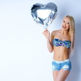 Happy sexy blond girl in short jeans Royalty Free Stock Photography