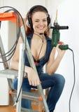 Happy  sexy builder in headphones Stock Image