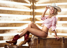 A happy and sexy cowgirl in a barn Stock Photo