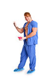 Happy sexy doctor with stethoscope and enema Stock Photography