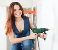 Happy sexy girl with drill Royalty Free Stock Photography