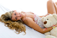 Happy sexy girl with teddy bear Royalty Free Stock Photos
