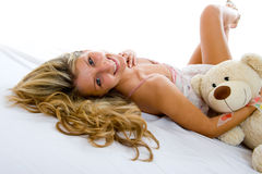 Happy sexy girl with teddy bear Royalty Free Stock Image