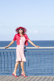 Happy sexy Mature woman ocean background Stock Photo