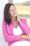 Happy mature woman portrait outdoor Stock Photos