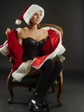 Happy sexy woman opening her Santa coat Stock Photography