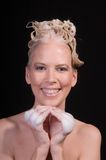 Happy Shampoo Girl. Close up of an attractive smiling blond girl while shampooing her hair Royalty Free Stock Photos