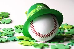 Happy shamrock day. Baseball with green derby in shamrocks Stock Images
