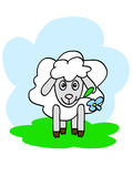 Happy sheep. A funny sheep chewing flower with happy muzzle Royalty Free Stock Photography
