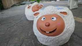 Happy sheep garden stool Stock Image