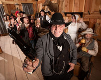 Happy Sheriff Arrests Group in Saloon Royalty Free Stock Image
