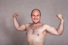 Happy shirtless man posing and showing his strong body Stock Photos