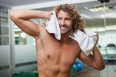 Happy shirtless man standing in gym Stock Photos