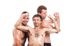Happy shirtless sportsmen posing Stock Photo