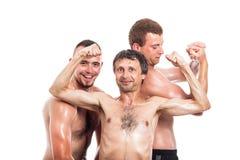 Happy shirtless sportsmen posing Stock Photo