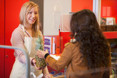 Happy shop assistant with customer in supermarket Royalty Free Stock Photos