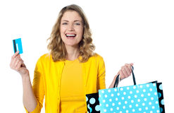 Happy shopaholic female laughing Stock Photo
