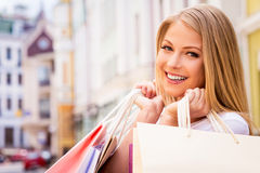 Happy shopaholic girl. Royalty Free Stock Image