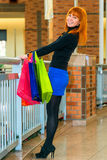 Happy shopaholic in the mall with  bags Stock Photography