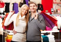 Happy shopaholics Stock Images