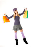 Happy shopper!. Beautiful young woman with shopping bags, isolated on white Royalty Free Stock Photo