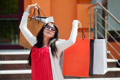 Happy fashion woman with shopping bags at the mall Stock Image