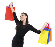 Happy shopper. Holding shopping bag high isolated on white background royalty free stock photo