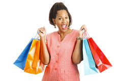 Happy Shopper with Bargains. Happy african-american woman with shopping bags.  Isolated on white Stock Images