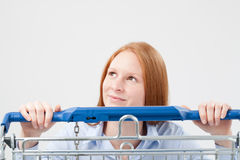 Happy Shopper Behind a Shopping Cart Royalty Free Stock Images