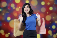 Happy shopper with christmas background Royalty Free Stock Photo