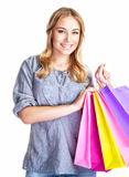 Happy shopper. Girl with four colourful paper bags isolated on white background, doing purchase, sale and spending money conception stock photography